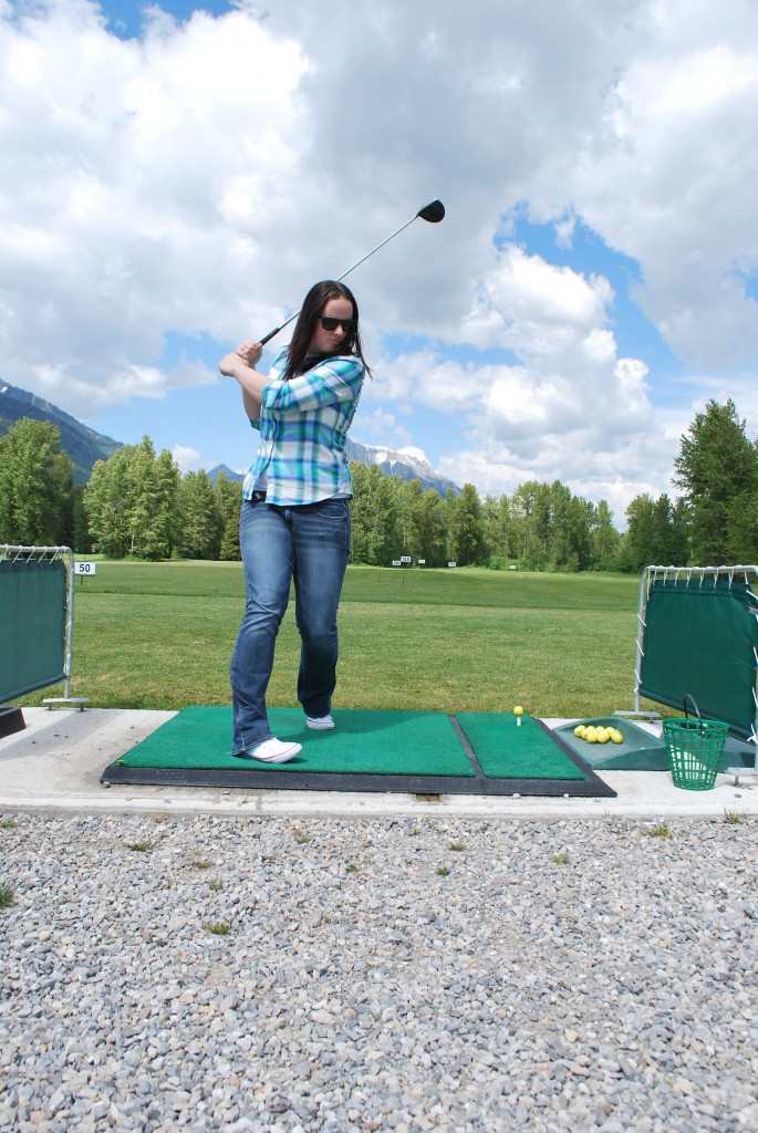 Golfing in Fernie at the driving range