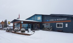 Snow falling on the Red Tree Lodge in Fernie BC